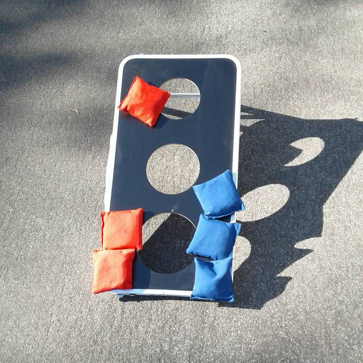 3 hole bean bag toss party game for rent from Big Blue Sky Party Rentals
