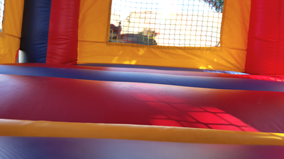 Inflatable Mini Bounce House Rental - Interior view of bouncing area and window.